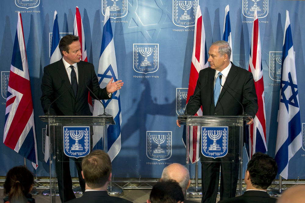Israeli Prime Minister Benjamin Netanyahu (R) and his British counterpart David Cameron attend a joint press conference in Jerusalem on March 12 2014, following their meeting. British Prime Minister David Cameron is on two days visit to Israel and Palestinian territories. Photo by Olivier Fitoussi/POOL/Flash90