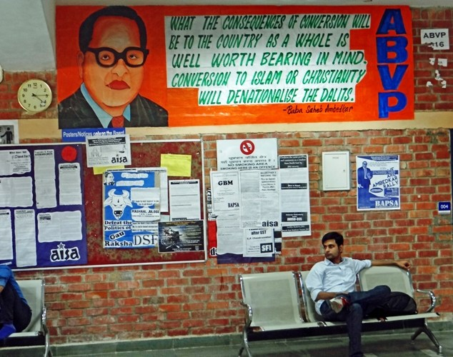 """This is the latest ABVP's poster put up on the wall of SIS building (new) of JNU with the portrait of Dr. Ambedkar. The poster qoutes him without mentioning the reference as saying that if Dalits convert to Islam or Christianity, it will """"denationalize them"""". Photo: Samim Asgor Ali"""