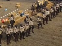 Armed With Riot Gear, Militarized Police Begin Forcibly Clearing DAPL Protest Camp