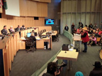 Standing Rock Sioux tribal member Olivia One Feather testifies before the Seattle City Council in favor of divestment from Wells Fargo. Photo by J. Gabriel Ware.