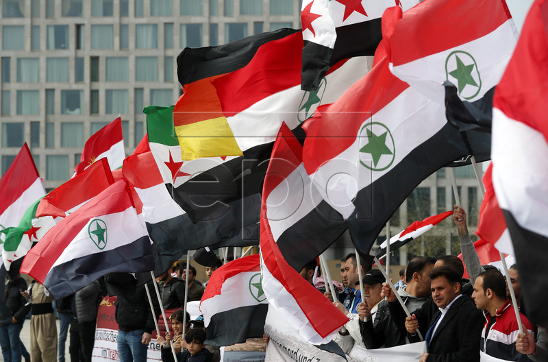 epa05919710 Demonstrators hold flags of the region of Al-Ahwaz as they take part in a rally in support of the Ahwazi minority in Iran, in Berlin, Germany, 21 April 2017. Dozens of demonstrators took part in the march striving for the recognition of this minority and their human rights. The Ahwazi live within the Iranian province of Khuzestan and constitute an ethnic, linguistic and cultural minority in Iran.  EPA/FELIPE TRUEBA