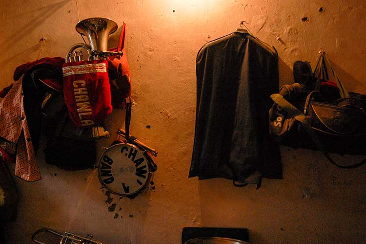 Musical instruments along with personal belongings of members are haung on the wall of their room in New Delhi: Photo Courtesy: Sadia Akhtar