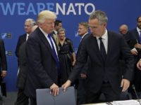 epa05990111 US President Donald J. Trump (L) and NATO Secretary General Jens Stoltenberg (R) grab for a seat during a working dinner meeting at the NATO summit in Brussels, Belgium, 25 May 2017. NATO countries' heads of states and governments gather in Brussels for a one-day meeting.  EPA/Matt Dunham / POOL