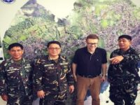 Andre Vltchek with military leaders in Marawi, Philippines.