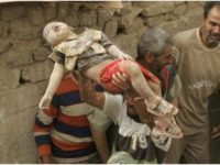 """A dead Iraqi child, victim of the """"Shock and Awe"""" attacks in Iraq"""