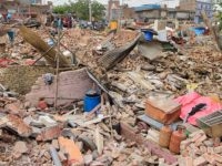 A view of Household belongings under the debris of demolished houses