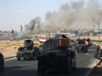 Smoke billows as Iraqi forces advance towards the centre of Kirkuk during an operation against Kurdish fighters on October 16, 2017. Iraqi forces seized the Kirkuk governor's office, key military sites and an oil field as they swept across the disputed province following soaring tensions over an independence referendum. / AFP PHOTO / AHMAD AL-RUBAYE        (Photo credit should read AHMAD AL-RUBAYE/AFP/Getty Images)