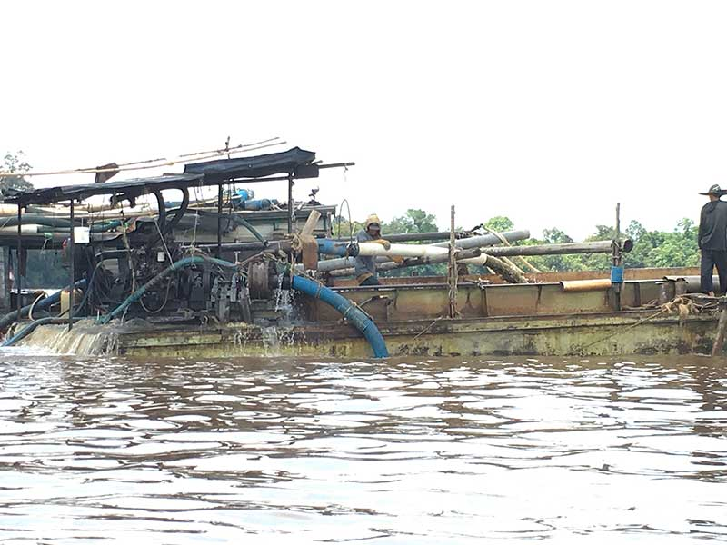 devilish mining machines on Borneo rivers