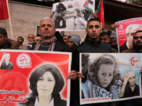 Protesters holding posters of Khalida Jarrar and Ahed Tamimi to show solidarity with Palestinian prisoners held in Israeli jails on 1 January in Gaza City. Ashraf Amra APA images