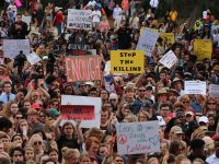 """Millions of Students Demand""""Never Again"""" to Gun Violence"""