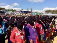 Zapatista women and thousands of women from around the world listen to the opening address kicking off the first International Political, Artistic, Sporting, and Cultural Gathering of Women who Struggle in the Zapatista Caracol in the Tzots Choj region, Chiapas, Mexico, March 8, 2018. Photo by Heather Gies