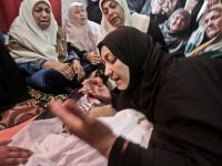 Ismail Abu Riyala's mother Kifa mourns during her son's funeral on 15 March. Abu Riyala was killed by the Israeli navy on 25 February. Mohammed Asad