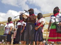 Zapatista women take the stage to deliver their speeches collectively from each Caracol, or administrative center. (WNV/Shirin Hess)