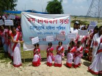 Childrens holding placards on the awareness programme at Beluguri village in Orang of Udalguri of Assam on Sunday.