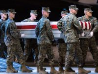 A Marine carry team moves a transfer case containing the remains of Lance Cpl. Nickolas A. Daniels at Dover Air Force Base, Del. Monday, Nov. 7, 2011. According to the Department of Defense, Daniels, 25, of Elmwood Park, Ill., died Nov. 5, 2011 while conducting combat operations in Helmand province, Afghanistan. (AP Photo/Steve Ruark)