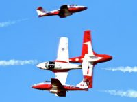 t092212 --- Clint Austin --- austinAIR0924c1 --- The Canadian Snowbirds perform a four plance cross manoeuver during thier performance at the Duluth Airshow Saturday afternoon. (Clint Austin / caustin@duluthnews.com)