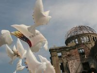 """On the eve of the 60th anniversary of the atomic bombing of Hiroshima, Greenpeace volunteers fly Peace Doves, bearing messages of peace, """"No More Hiroshima"""", """"Yes to Peace"""",  """"No to Rokkasho"""" in Japanese and in English, beside the A-Bomb Dome Memorial in Hiroshima. Greenpeace renews their calls for peace and make this anniversary a message to world leaders to make real their commitments to nuclear disarmament, including the Japanese government to abandon plans to produce nuclear weapons."""