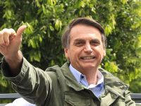RIO DE JANEIRO, BRAZIL - OCTOBER 28: Jair Bolsonaro, far-right lawmaker and presidential candidate of the Social Liberal Party (PSL), gestures after casting his vote during general elections on October 28, 2018 in Rio de Janeiro, Brazil.  (Photo by Buda Mendes/Getty Images)