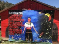 """At the 2018 International Summit for Women in the Struggle called by the Zapatistas. The mural reads: """"Capitalism converts everything, absolute everything into commodities. For it [capitalism] we women are propaganda, decorations…Down with this capitalist system!"""" Photo credit: Global Justice Now/Flickr/CC 2.0"""