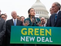 US Representative Alexandria Ocasio-Cortez, Democrat of New York, and US Senator Ed Markey (R), Democrat of Massachusetts, speak during a press conference to announce Green New Deal legislation to promote clean energy programs outside the US Capitol in Washington, DC, February 7, 2019. (Photo by SAUL LOEB / AFP)        (Photo credit should read SAUL LOEB/AFP/Getty Images)