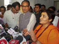 Bhopal: BJP candidate for Bhopal Lok Sabha seat Sadhvi Pragya Singh Thakur, with BJP vice president Shivraj Singh Chouhan, addresses a press conference at the party's state headquarters in Bhopal, Wednesday, April 17, 2019. BJP has fielded Thakur, an accused in the 2008 Malegaon blasts, as its candidate against Congress leader Digvijay Singh. (PTI Photo)  (PTI4_17_2019_000160B)