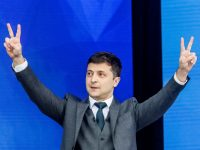 Presidential candidate Volodymyr Zelenskiy reacts during a policy debate with his rival, Ukraine's President Petro Poroshenko at the National Sports Complex Olimpiyskiy stadium on April 19, 2019, in Kyiv.