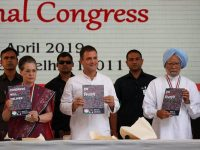 Rahul Gandhi (C), President of India's main opposition Congress party, his mother and leader of the party Sonia Gandhi and India's former Prime Minister Manmohan Singh (R) display copies of their party's election manifesto for the April/May general election in New Delhi, India, April 2, 2019. REUTERS/Adnan Abidi