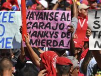 Workers from Venezuela's state oil company, PDVSA, participate in an anti-imperialist march  to support Venezuelan President Nicolas Maduro, in front of the Miraflores Presidential Palace in Caracas, Venezuela on January 31, 2019.  The US slapped sanctions on Venezuela's state oil company PDVSA in an attempt to cut off a vital source of funds. (Photo/YURI CORTEZ/AFP/Getty Images)