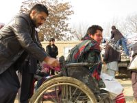 Arriving in wheelchairs to receive duvets/ Photo credits:  Dr. Hakim