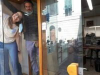 The owners of a shoe repair shop in Florence (*). In this picture, taken just after the end of the coronavirus lockdown, they are preparing to reopen their shop. They look happy, even euphoric. Time will tell if that optimism was justified.