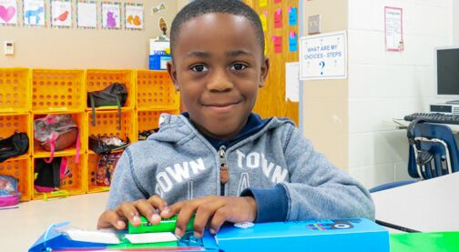 Donate School Supplies, Hillsborough Education Foundation, young student boy in class, smiling