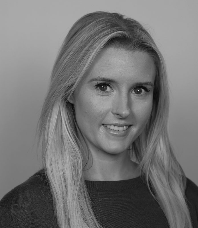 Amber Sale, young adult woman with blonde hearing, smiling, large eyes, black and white headshot, Hillsborough Education Foundation