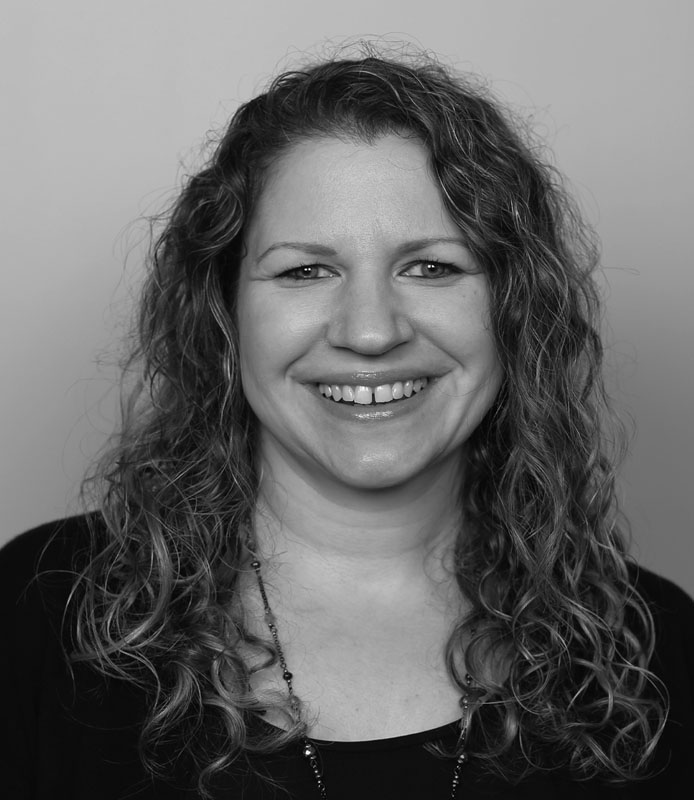 Denise Becker, middle-aged adult woman with light curly hair, wearing black shirt, black and white headshot, Hillsborough Education Foundation