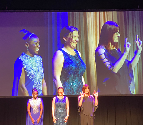 Excellence in Education Awards winners on stage