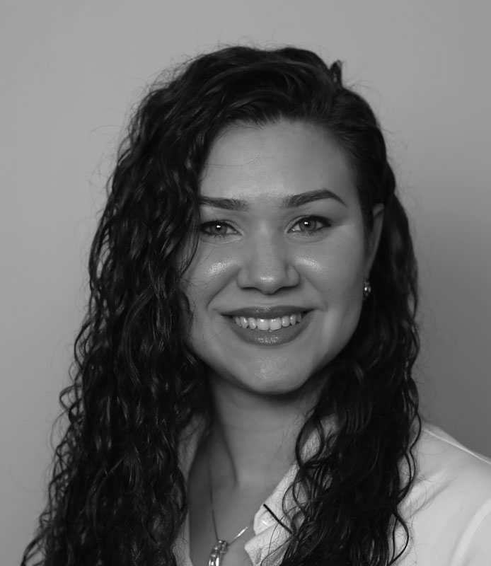 Elisabet Rivera, young woman with long curly hair, black and white headshot, Hillsborough Education Foundation