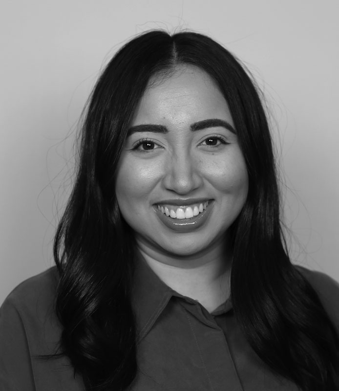 Joanne Sandoval, young adult woman with black hair, black and white head shot Hillsborough Education Foundation