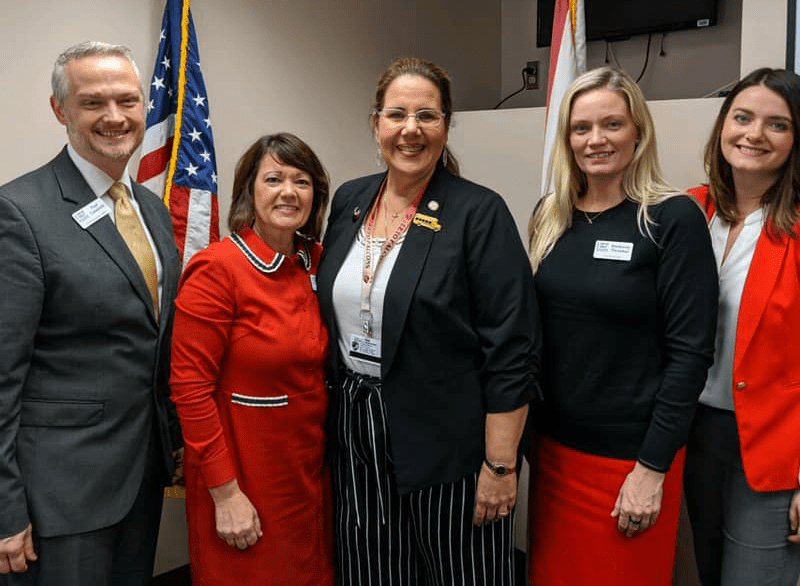 HEF staff and Board Member pose with Rep. Susan Valdes