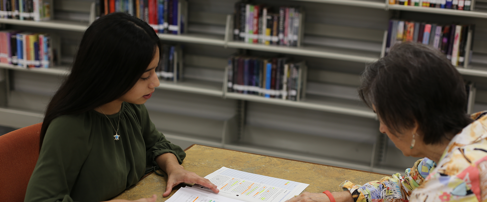 Take Stock in Children student and mentor studying in a library