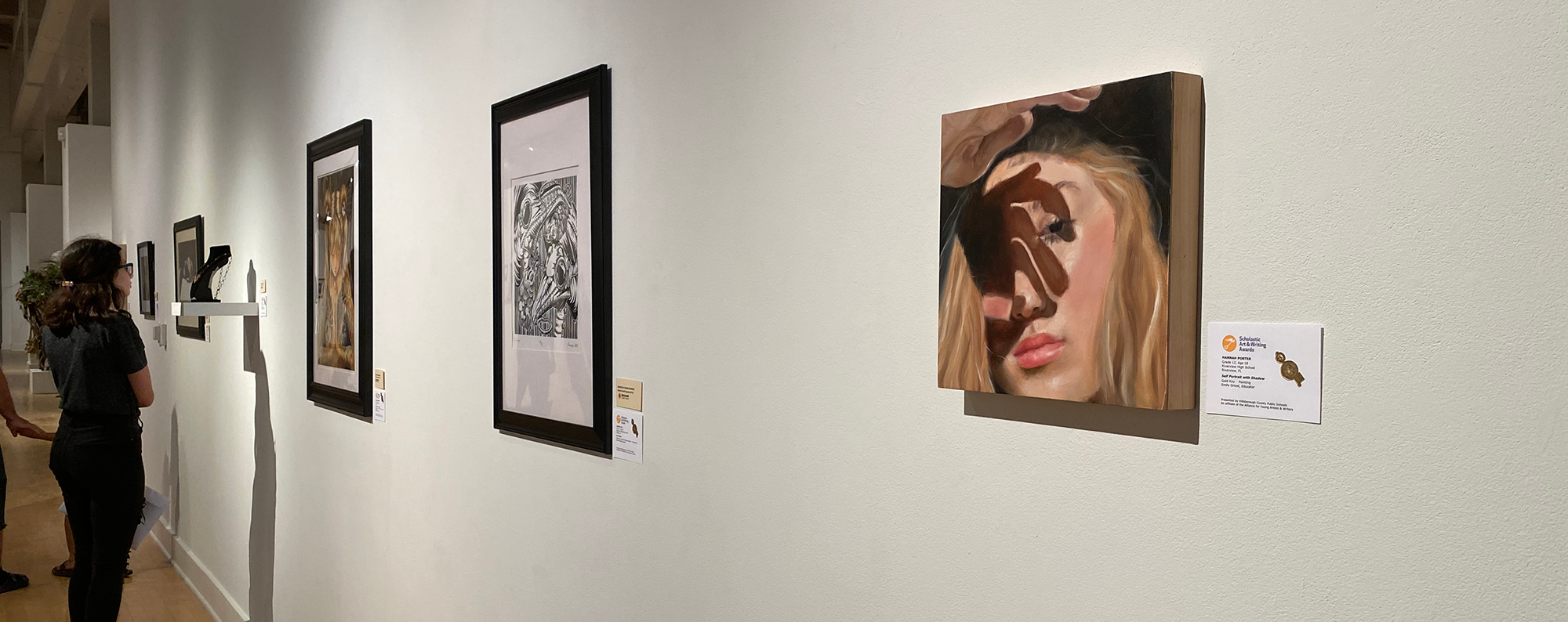 Attendees of the Scholastic Art & Writing Awards view art that is being exhibited