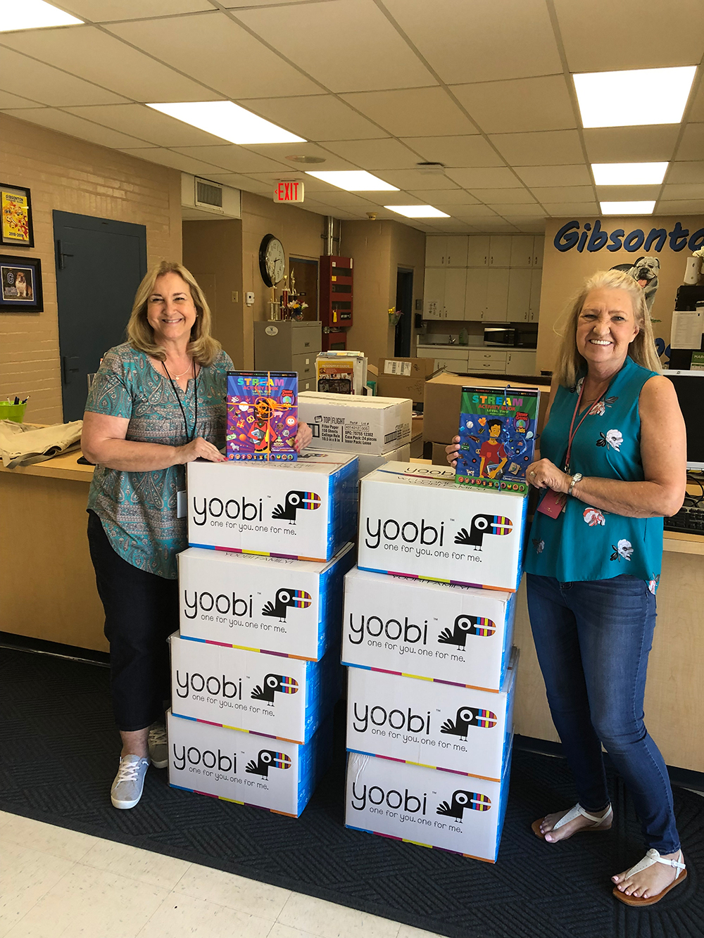 Staff at Gibsonton Elementary pose with supplies provided by Hillsborough Education Foundation