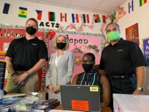 Teachers and Staff pose with Humana Masks after Hillsborough Education Foundation distribution