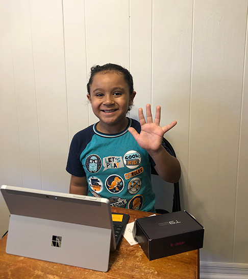 Student with devices provided by Hillsborough Education Foundation