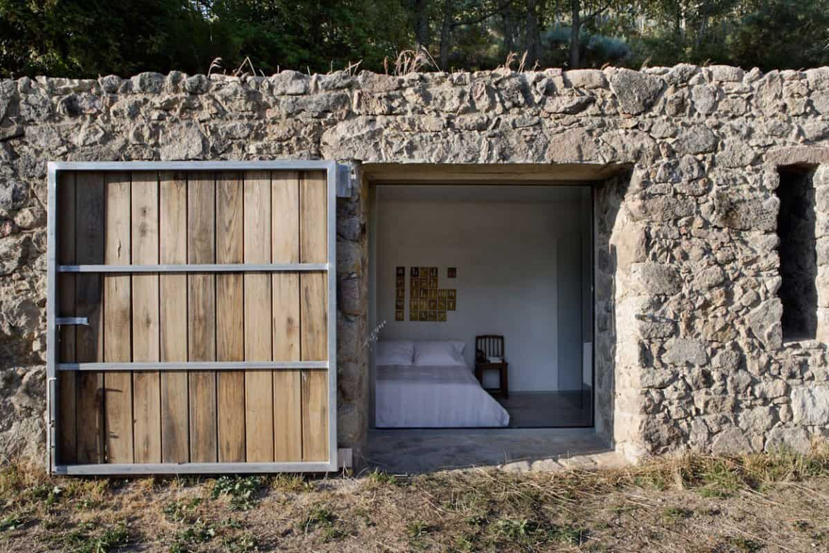 Fabulous-Bedroom-View-in-Finca-en-Extremadura-with-Wide-Bed-White-Quilt-White-Cushions-and-Concrete-Floor