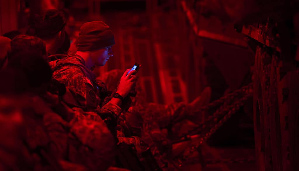 A_U.S._Soldier_assigned_to_Apache_Troop_1st_Squadron_2nd_Cavalry_Regiment_checks_his_phone_prior_to_offloading_from_an_Air_Force_C-17_Globemaster_III_aircraft_in_Latvia_Sept_140905-F-IM476-006