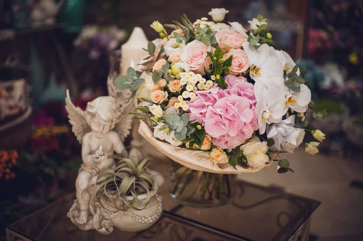 beautiful delicate bridal bouquet on the table. floral wedding theme.