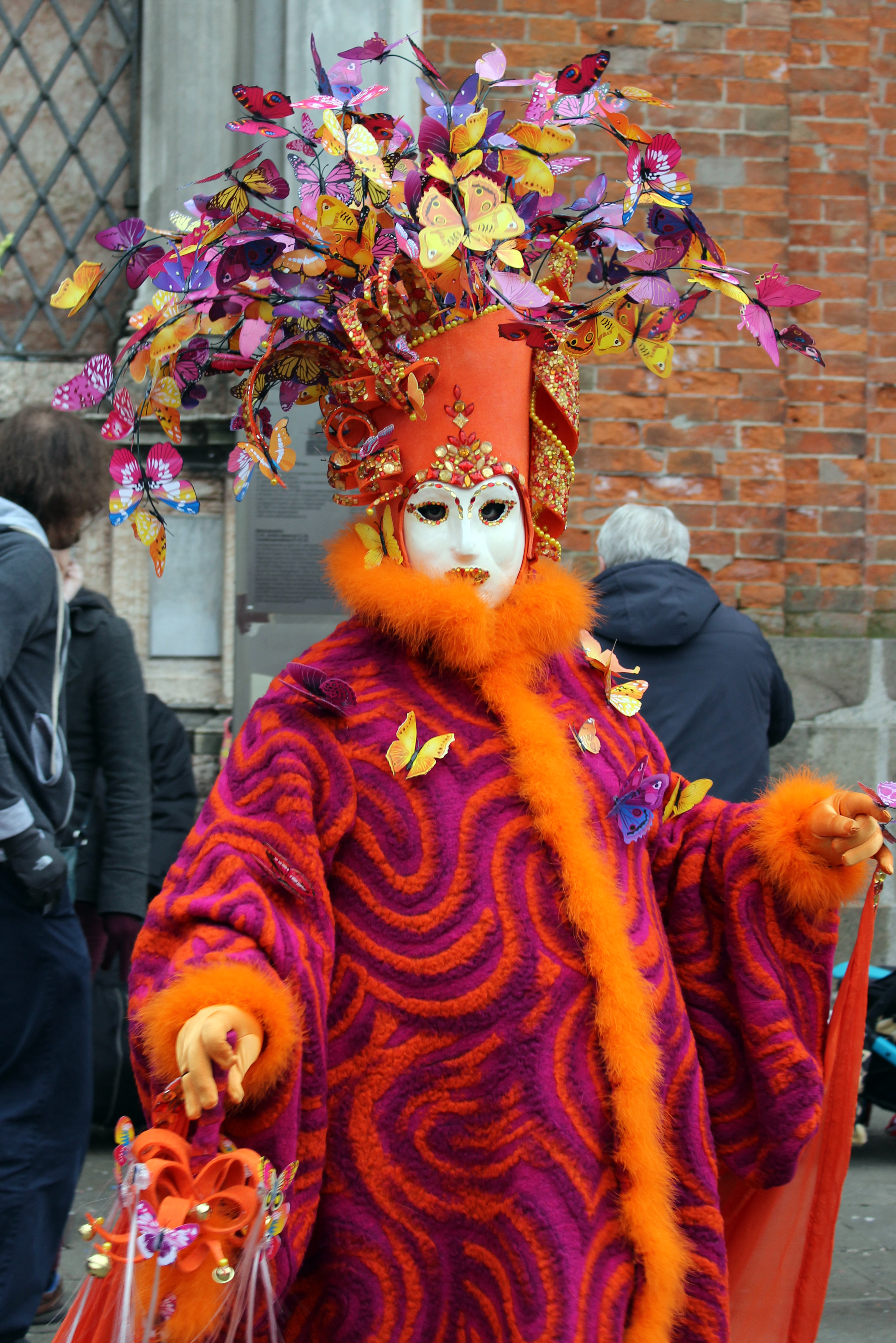 Masquerade with Butterflies on Hat in Venice Italy during Carnevale