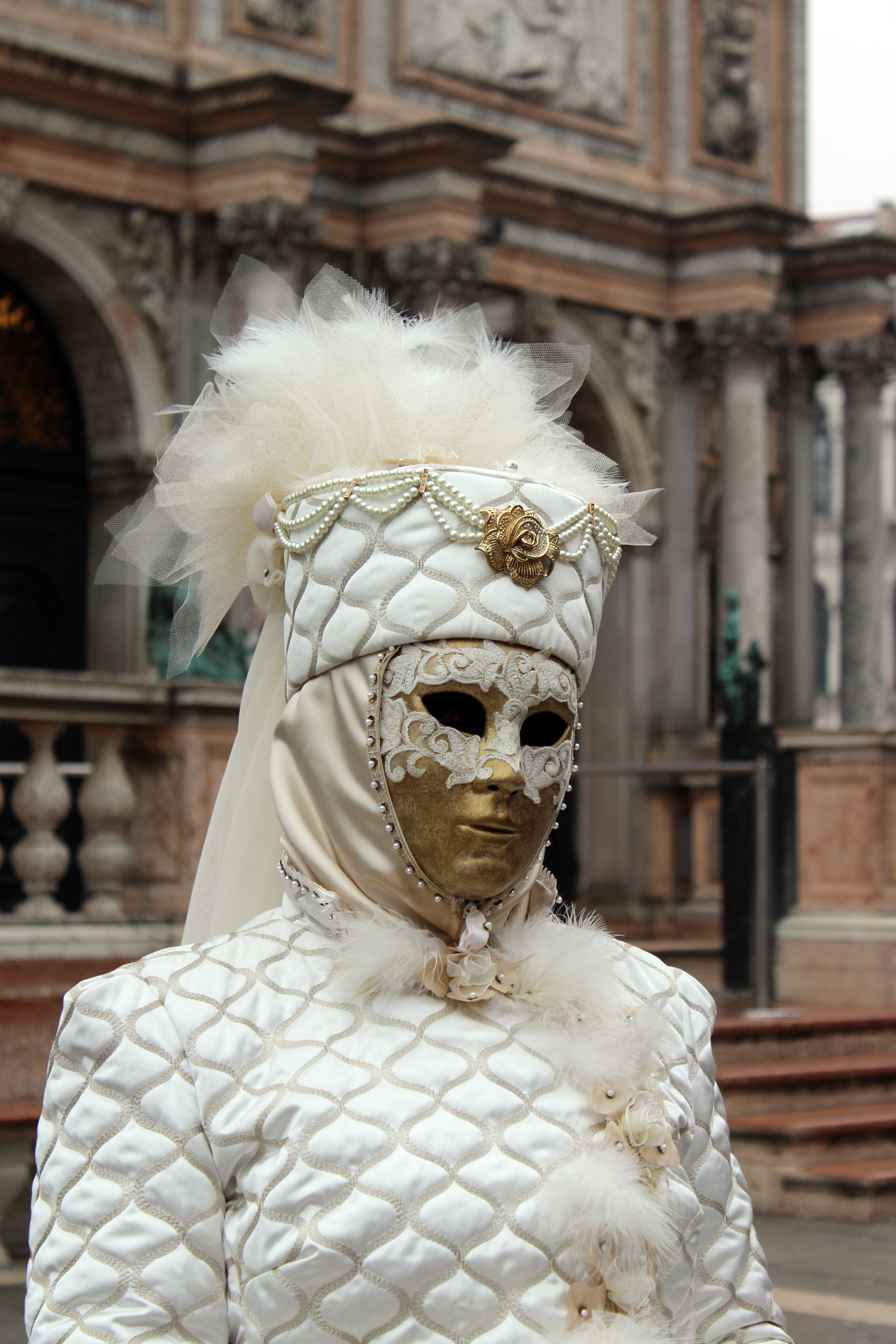 White and Gold Mask in Venice Italy during Carnevale