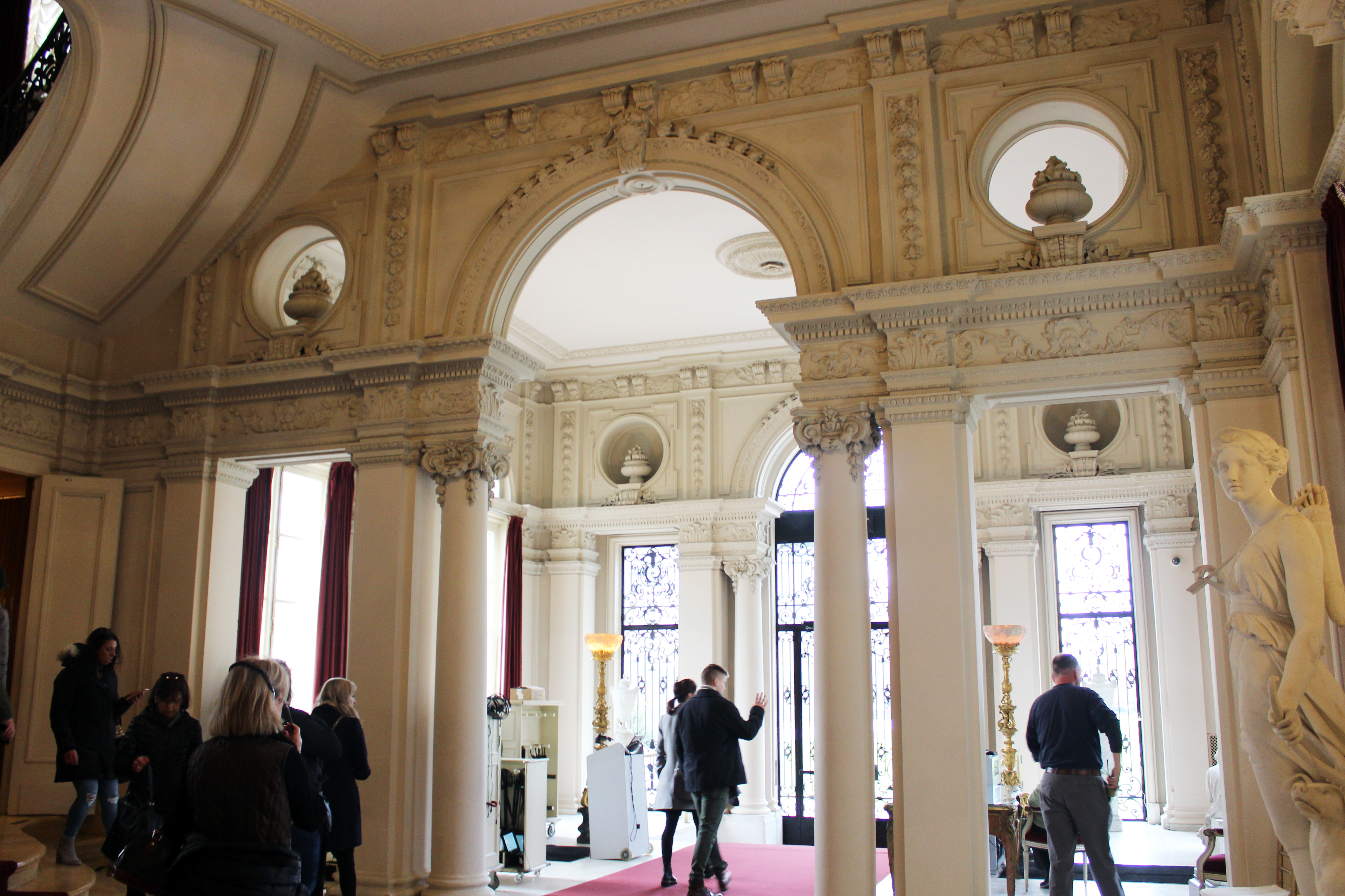 Rosecliff Mansion - Newport RI | The entryway of Rosecliff features an open-air colonnade, paired ionic columns, second story pilasters, and a roofline balustrade.