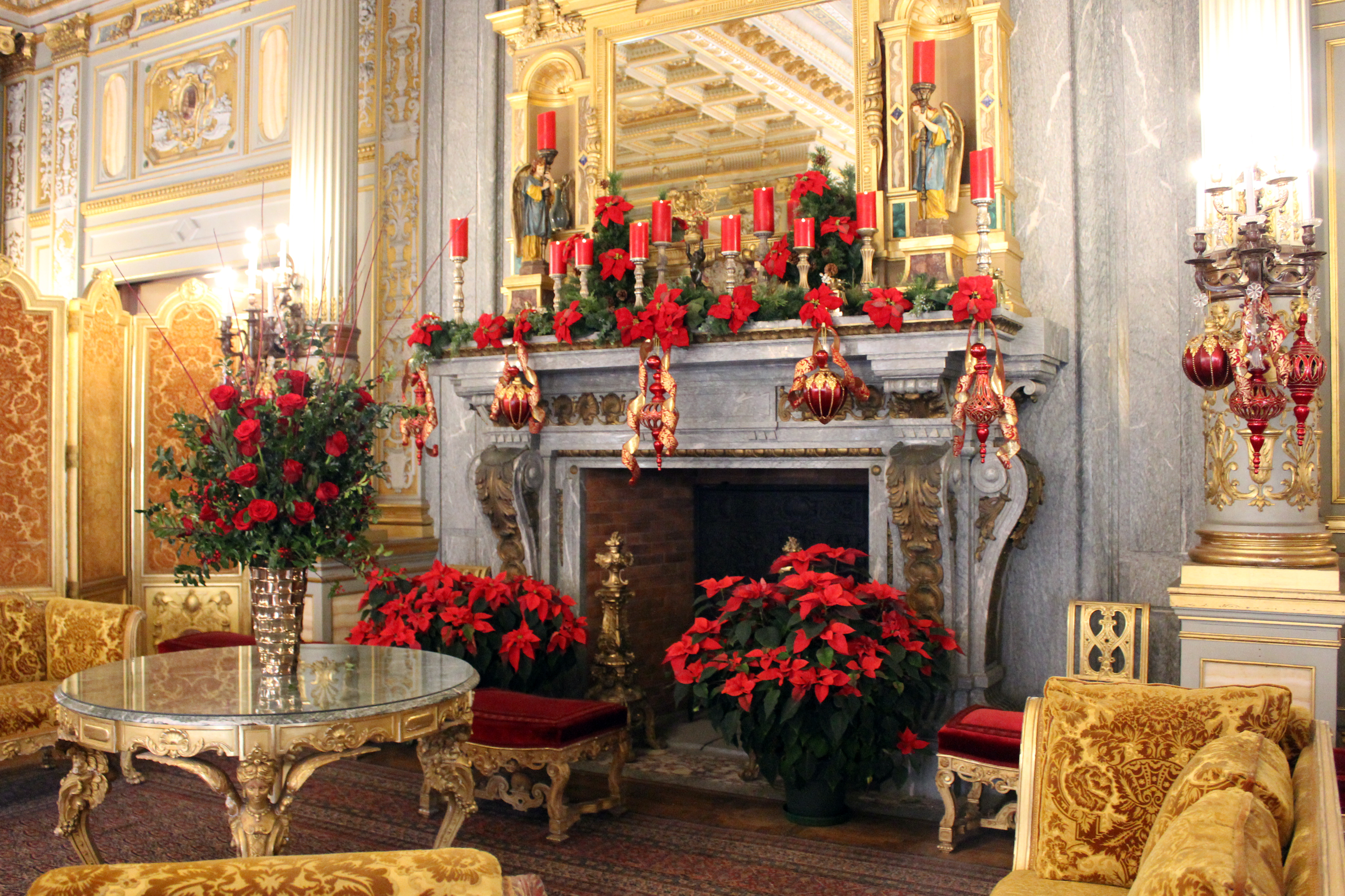The Breakers - Newport RI | Vibrant holiday decorations surround the Campan marble fireplace of the gilded Music Room, once used for recitals and dances.