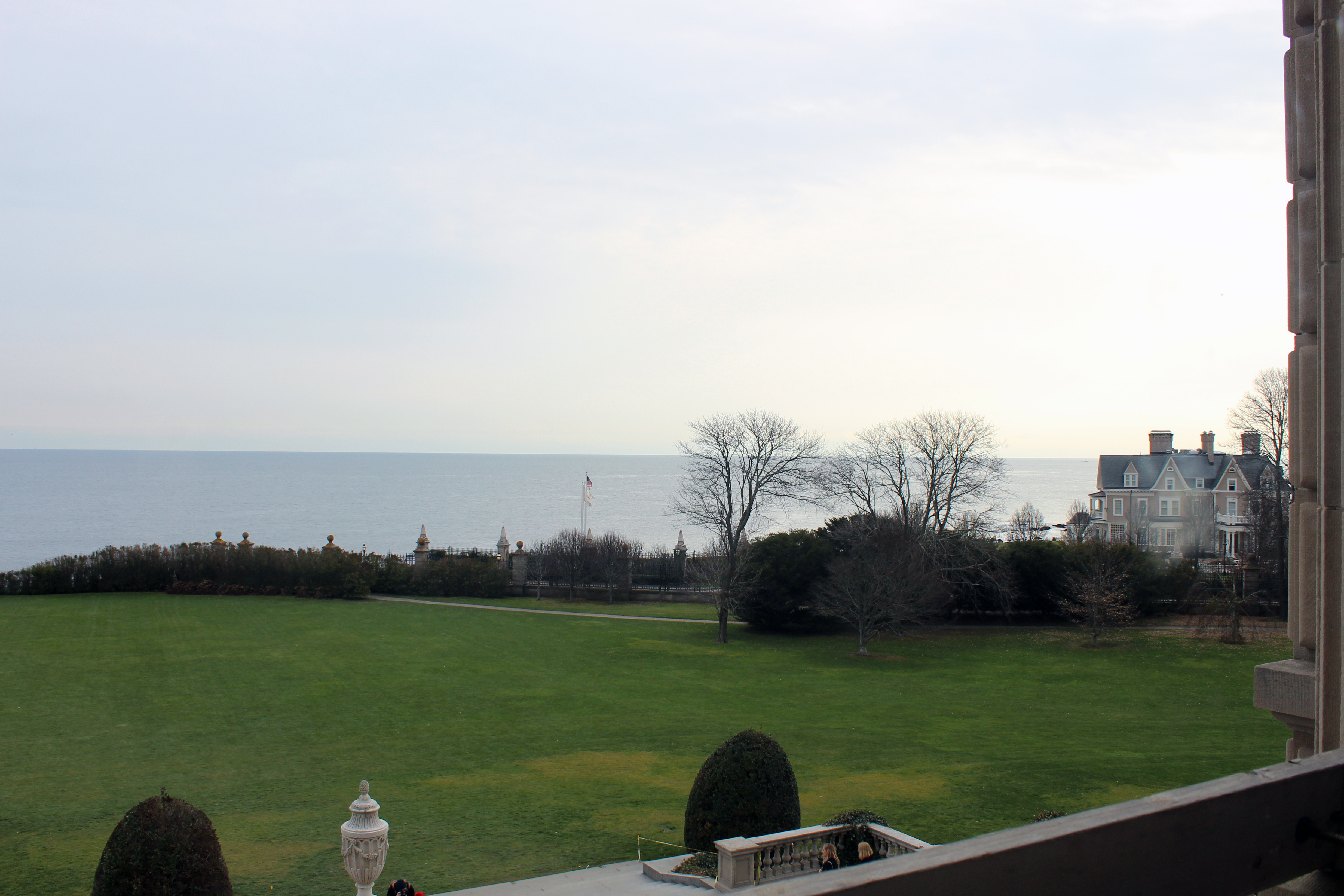 The Breakers - Newport RI | The rear facing rooms of The Breakers Newport mansion offers views of the manicured property leading up to the Atlantic Ocean. The Cliff Walk follows the perimeter, dividing the two.